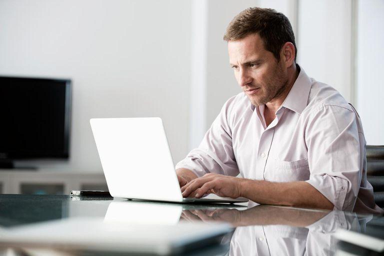 Man using laptop at his desk