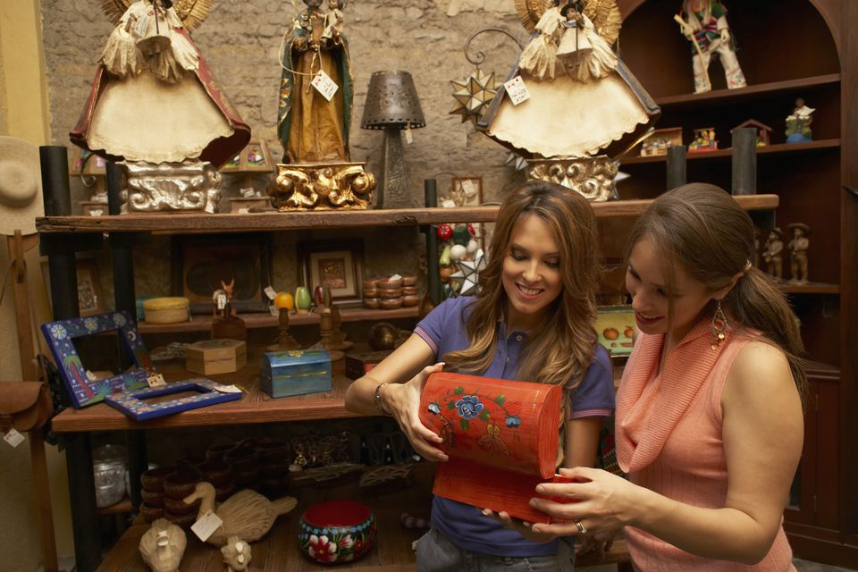 Two young women shopping at an antique mall.