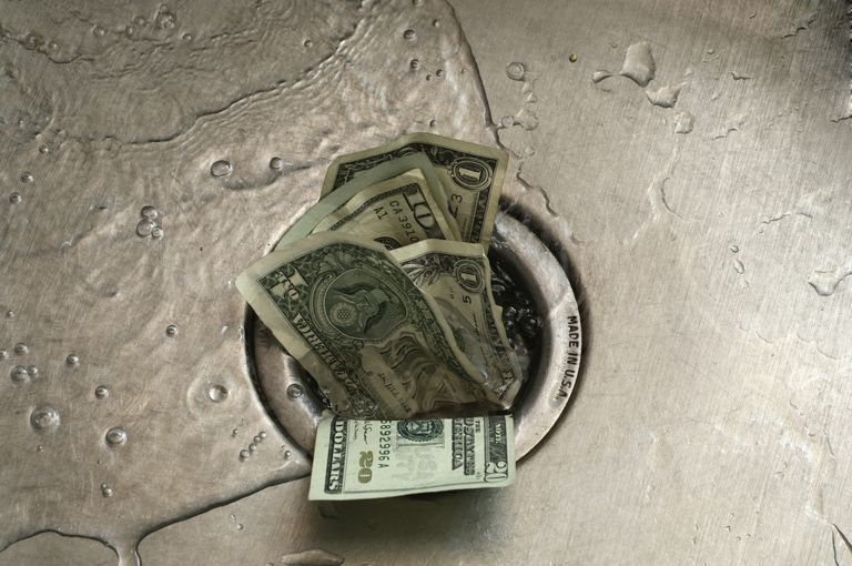 Photo of money going down a sink drain
