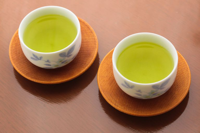 Green tea in two japanese ceramic cups