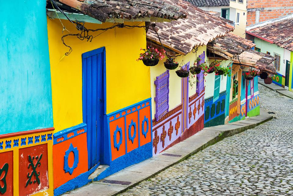 Cobbled Street By Multi Colored Houses In Town