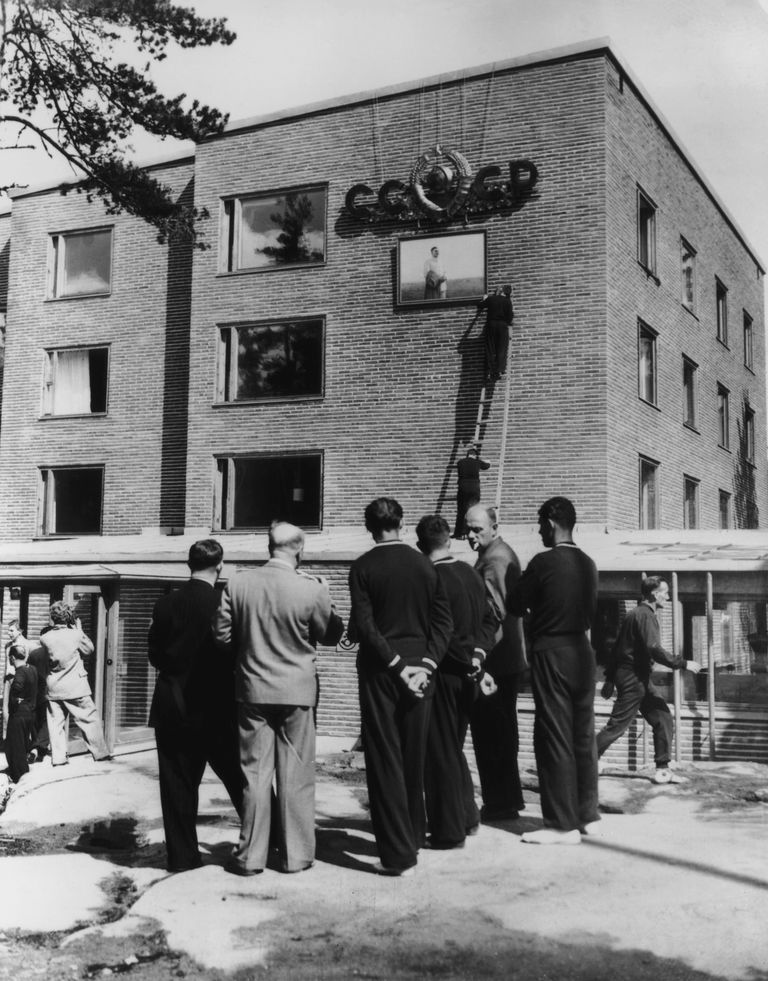 Adding a portrait of Stalin to the Soviet Olympic village during the 1952 Olympic Games.