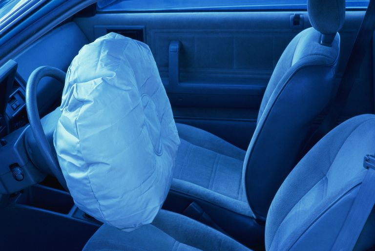 Interior shot of car with deployed airbag
