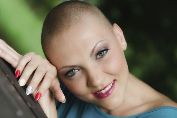 bald woman breast cancer patient smiling