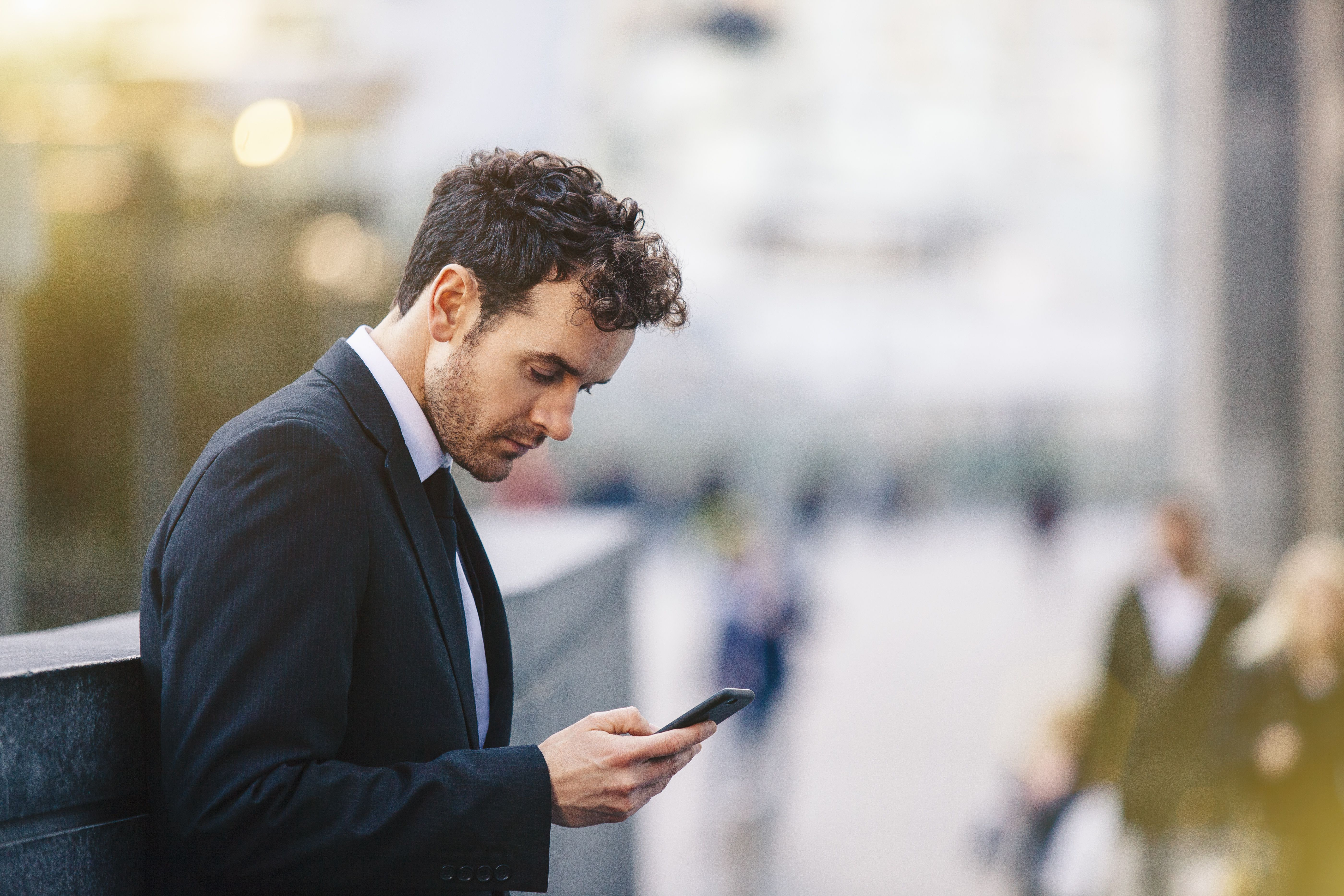 Heres what to do if youve blown a job interview businessman checking phone aljukfo Images