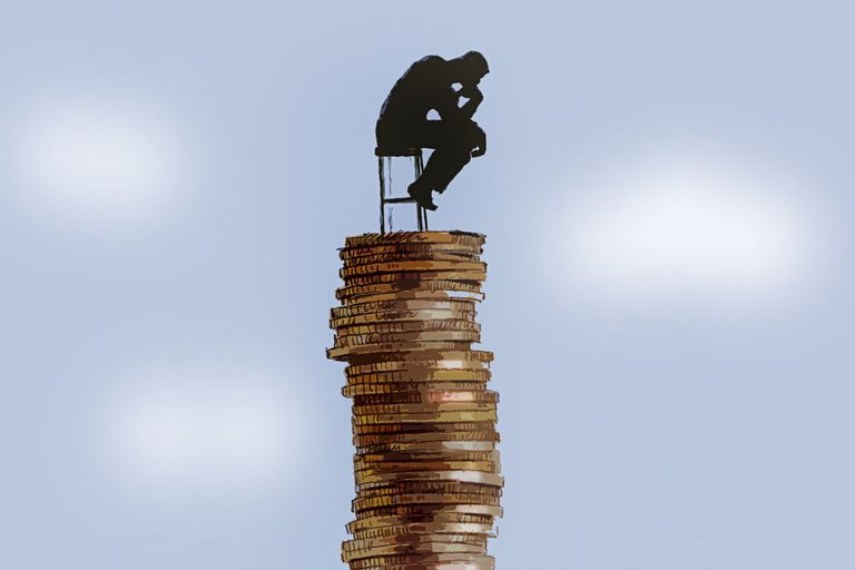 Sitting on stack of coins