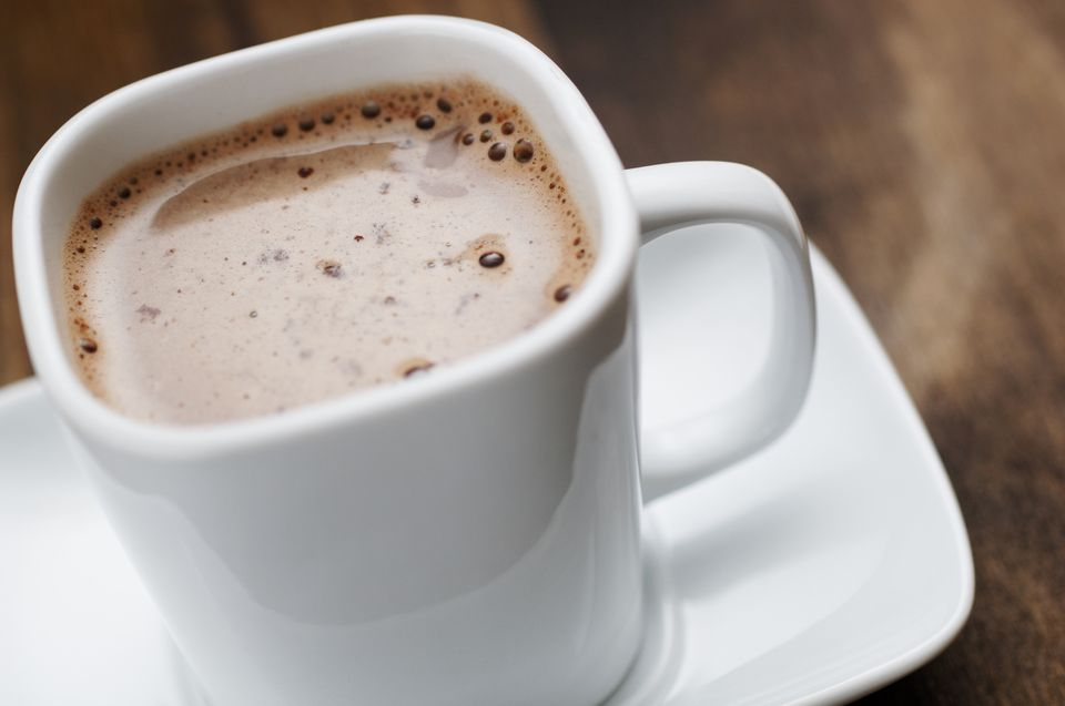 close up of square cup filled with hot chocolate drink
