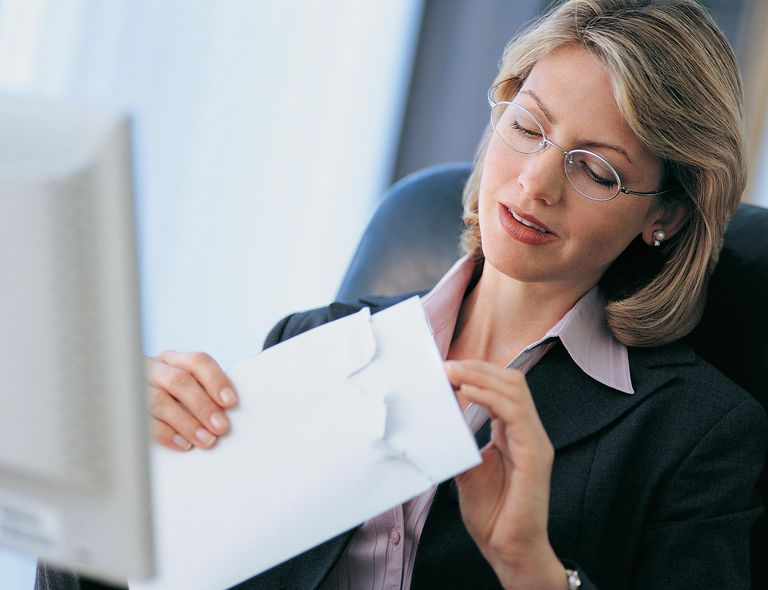 Businesswoman Opening Her Mail at Her Desk