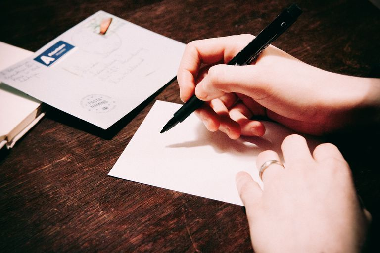 A person at the start of writing a letter