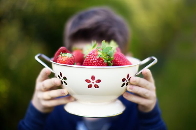 Boy holding strawberries