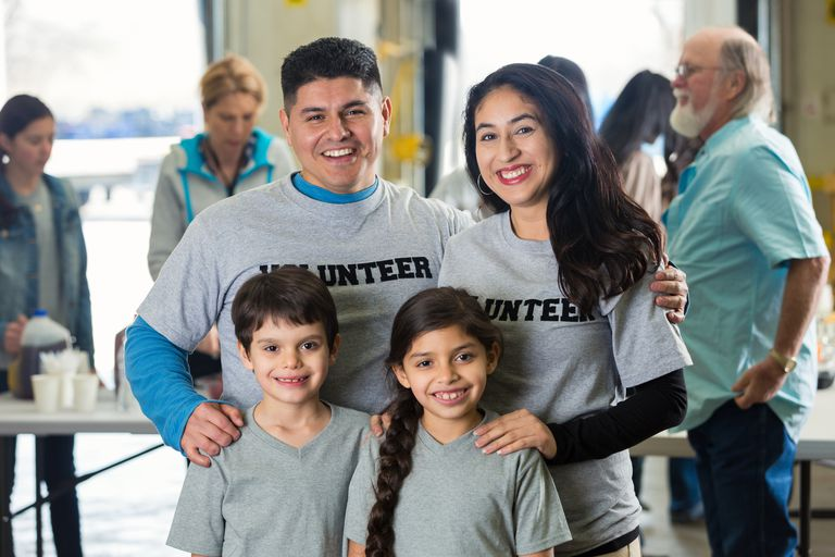 Family of four volunteering at a food bank