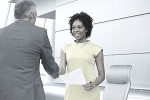 Business people shaking hands in meeting