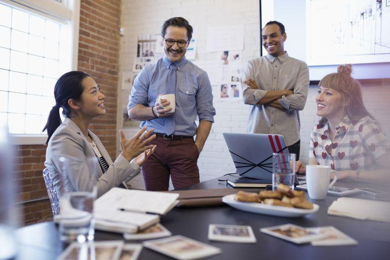 Coworkers talking in a meeting