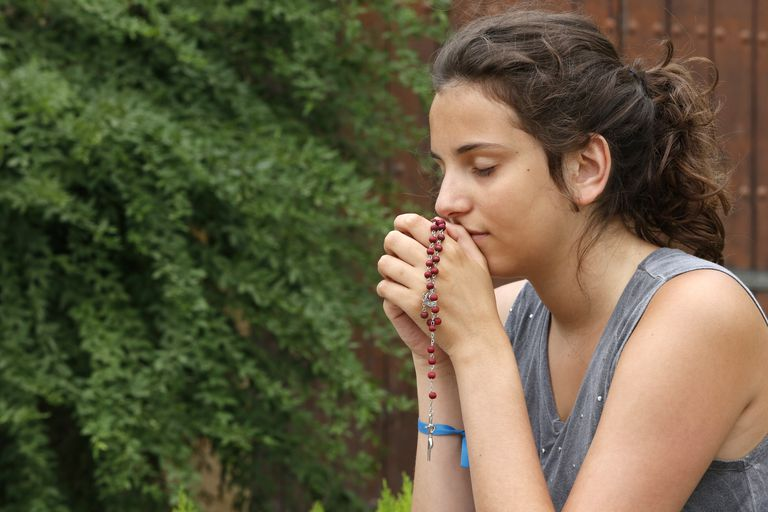 Praying teenager