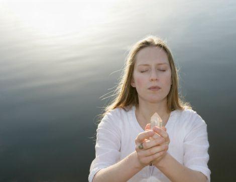 girl holding quartz crystal in hands