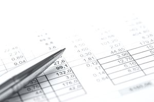A silver pen on top of an accounting report