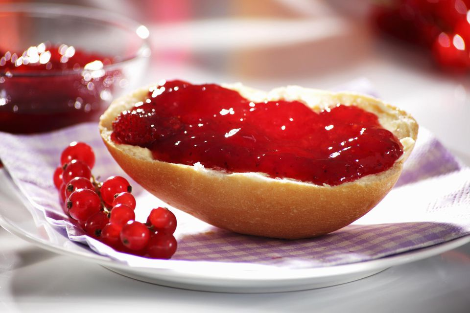 Redcurrant jam on bread roll