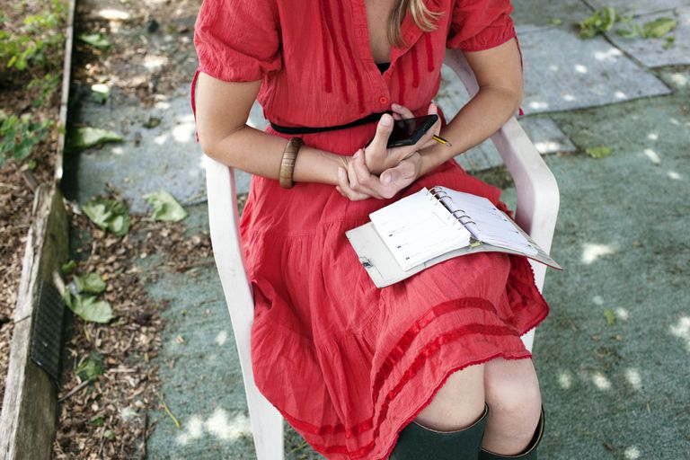 woman with day planner in her lap