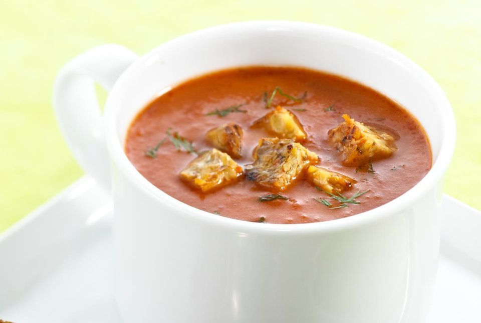 Tomato carrot soup topped off with tempeh - a healthy whole foods meal.