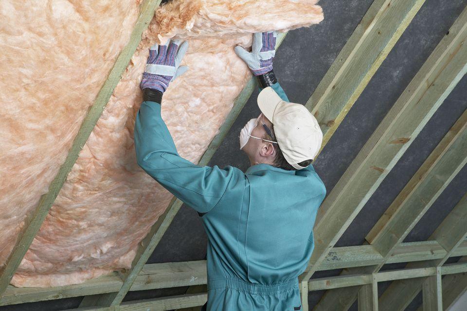 Worker Insulating Attic