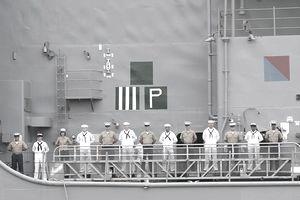 Sailors man the rails on the USS Oak Hill