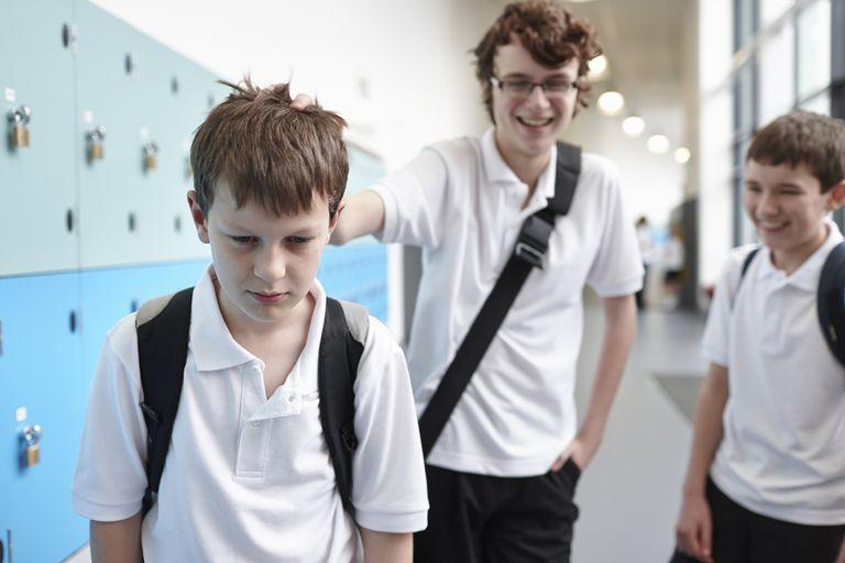 A boy is bullied by classmates.