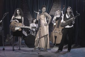 Group of women performing jazz band on stage