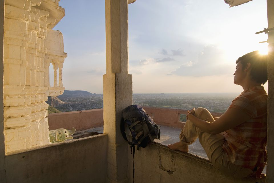 Woman Sitting In Small Temple At Dusk, Jaipur