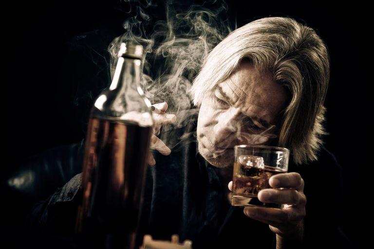 Senior Man Drinking and Smoking