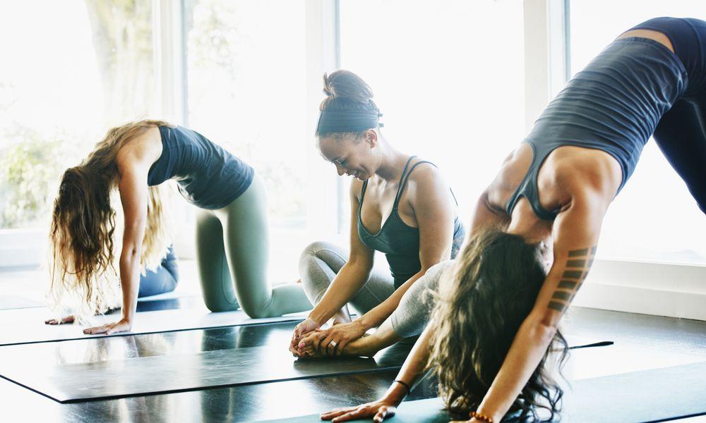 three women in yoga class
