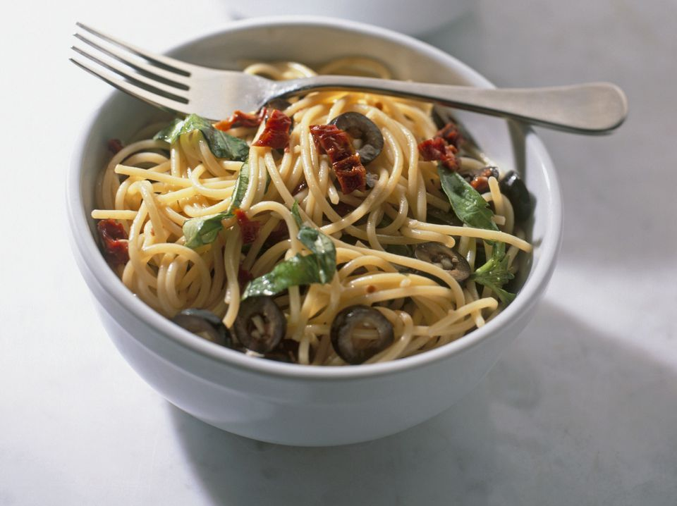 Vegetarian pasta with artichokes, black olives and sun dried tomatoes