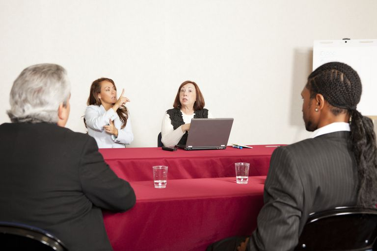 Adult training or seminar event with interpreter