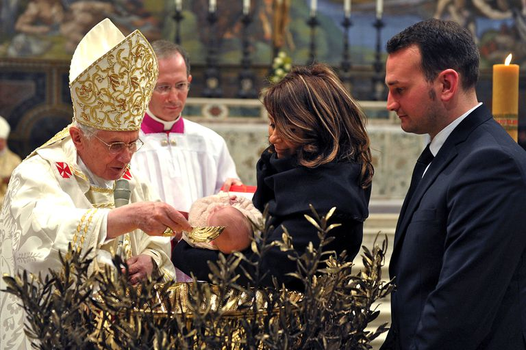 Pope Benedict baptizes a child. (L'Osservatore Romano Vatican Pool/Getty Images)
