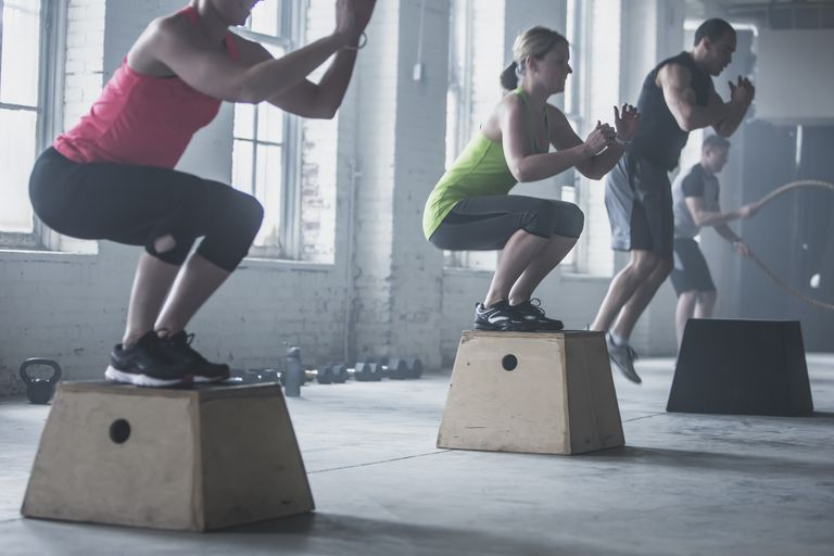 group doing box jumps in the gym