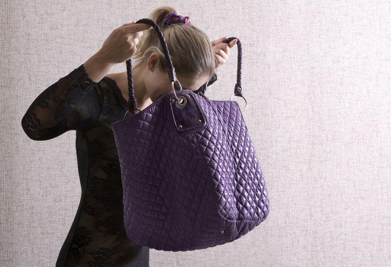Woman looking in purse