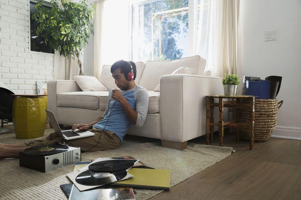Man sitting on vinyl floor