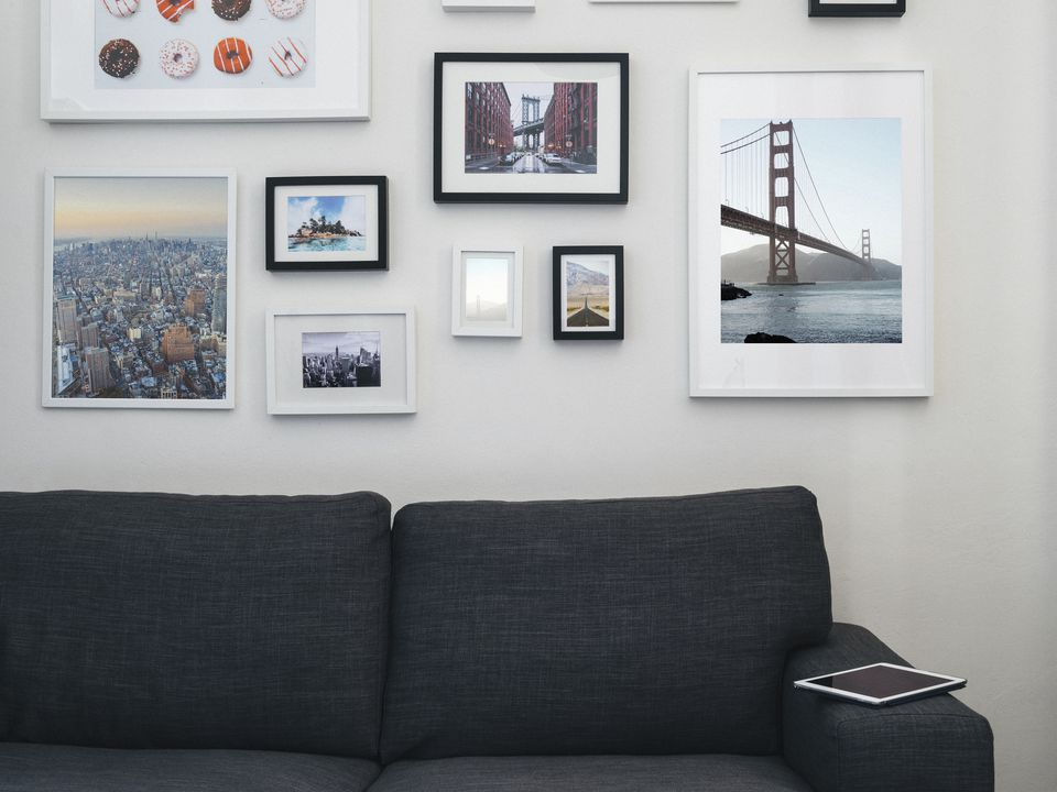 Home interior with sofa and paintings on the wall