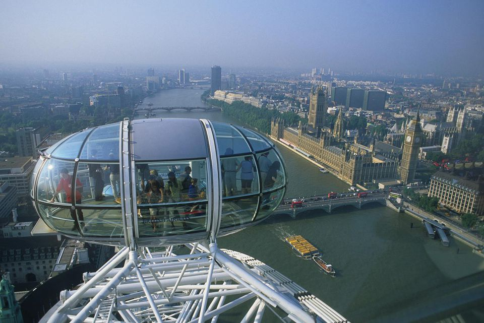 England, London, people on Millennium Wheel and cityscape
