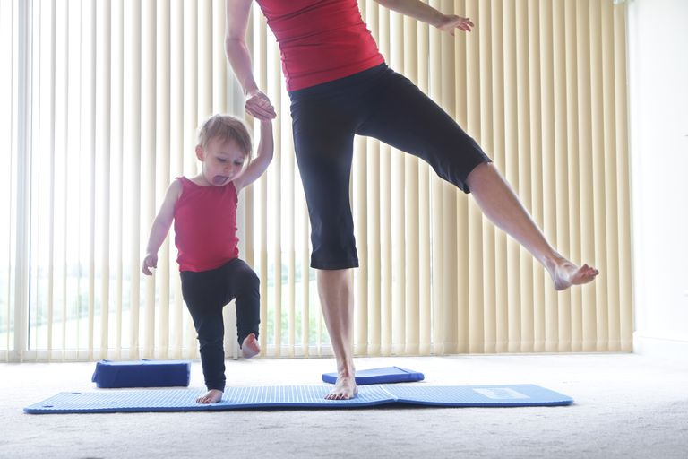 mother and child exercising together