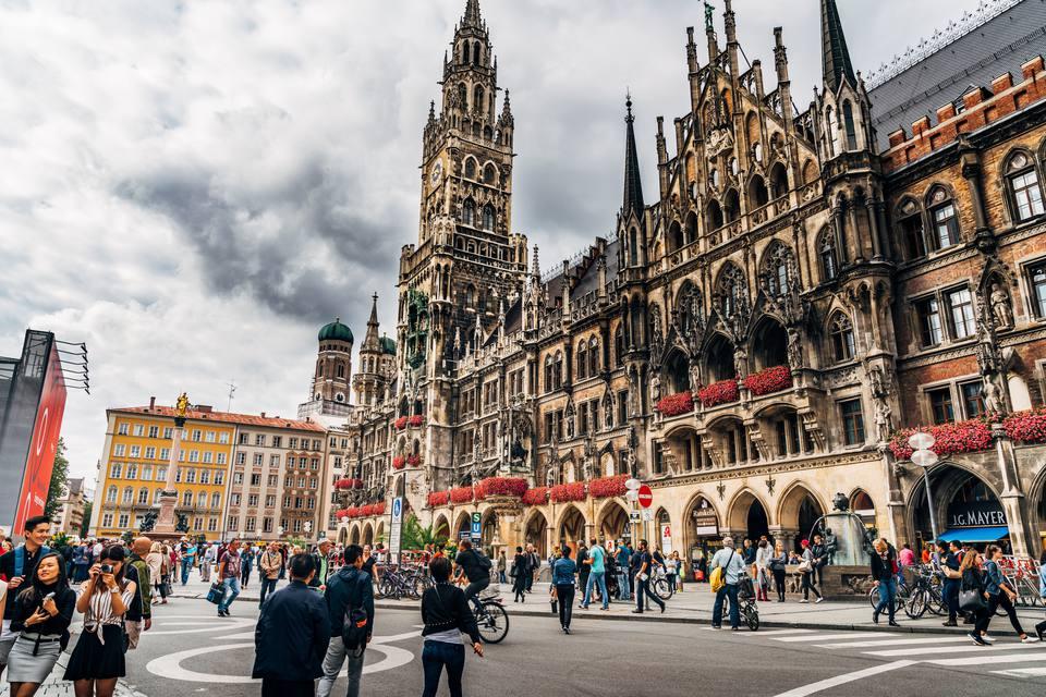 People Walking On Street By New Town Hall At Marienplatz