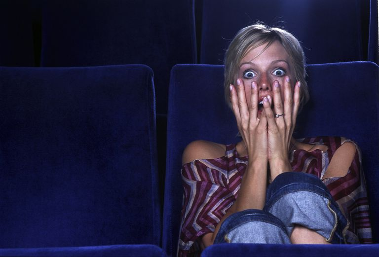 Woman Watching Horror Movie