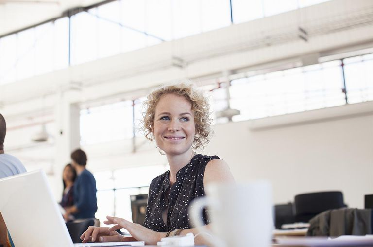 Businesswoman working on laptop in modern office