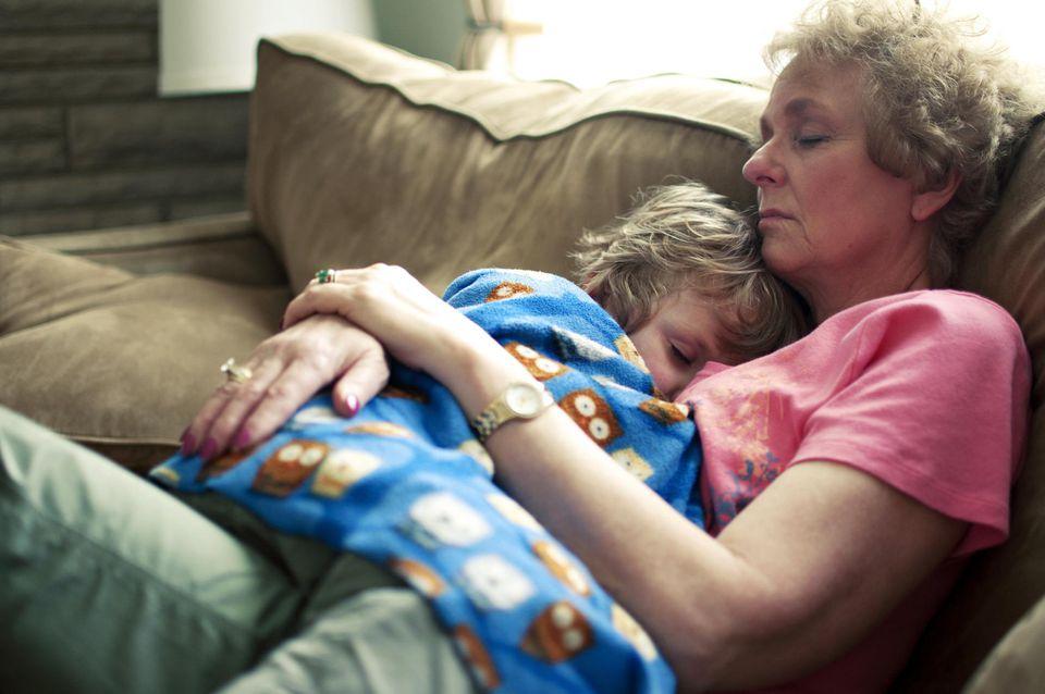 Grandma and boy sleeping on couch