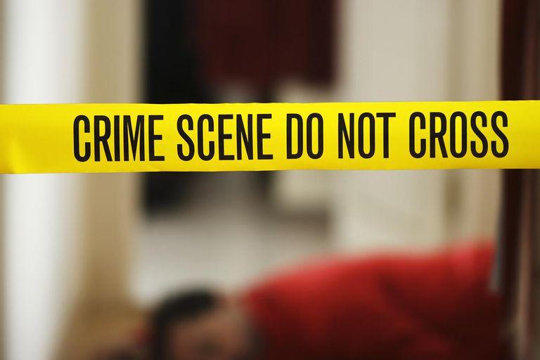 CSI: Murder victim and crime scene tape