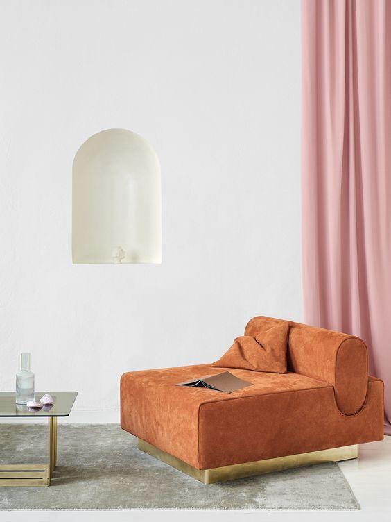 Stylishly designed white room with orange sofa and pink curtains