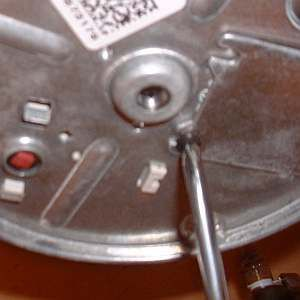 A photo of an electrical cover plate being removed.
