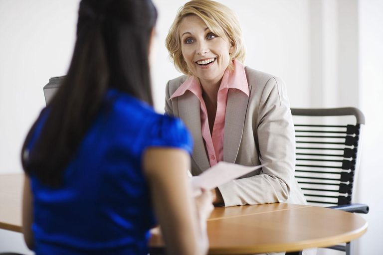 Attentive businesswoman with client