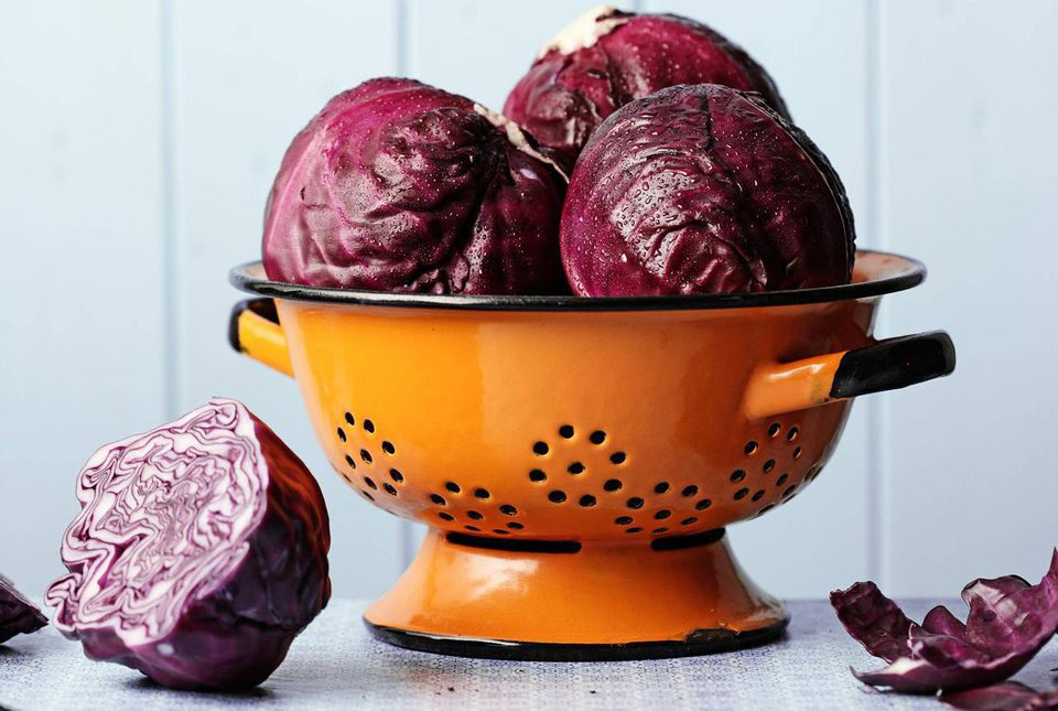 Red Cabbages in colander on kitchen table