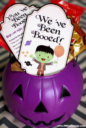 A candy bucket full of candy and we've been booed printables.