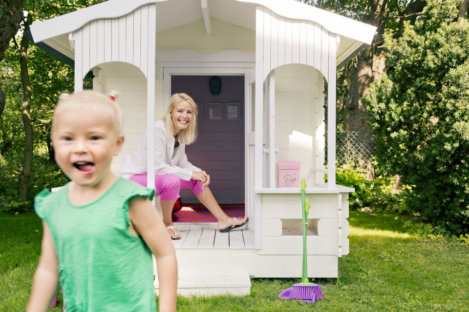 little girl with playhouse